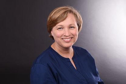 Dorothea Beckmann: Sie trägt eine dunkel blaue Bluse und hat kurze braune Haare. - Copyright: Fachdienst Ev. Kindertagesstätten